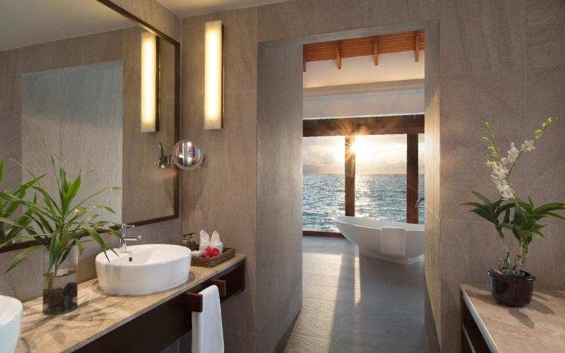 Sunset Over Water Pool Suite